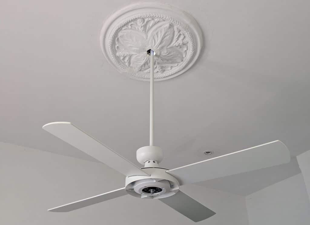 white ceiling fan on extension rod through ceiling rose