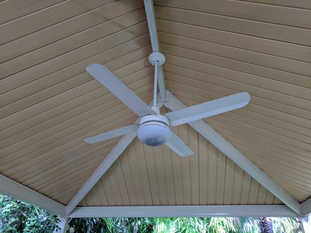 white ceiling fan showing signs of water ingress and corrosion